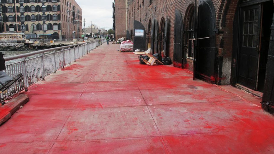 Red pigment from the studio of participant artist Bosco Sodi, flooded across the Van Brunt Street pier in Red Hood, Brooklyn. October 2012.