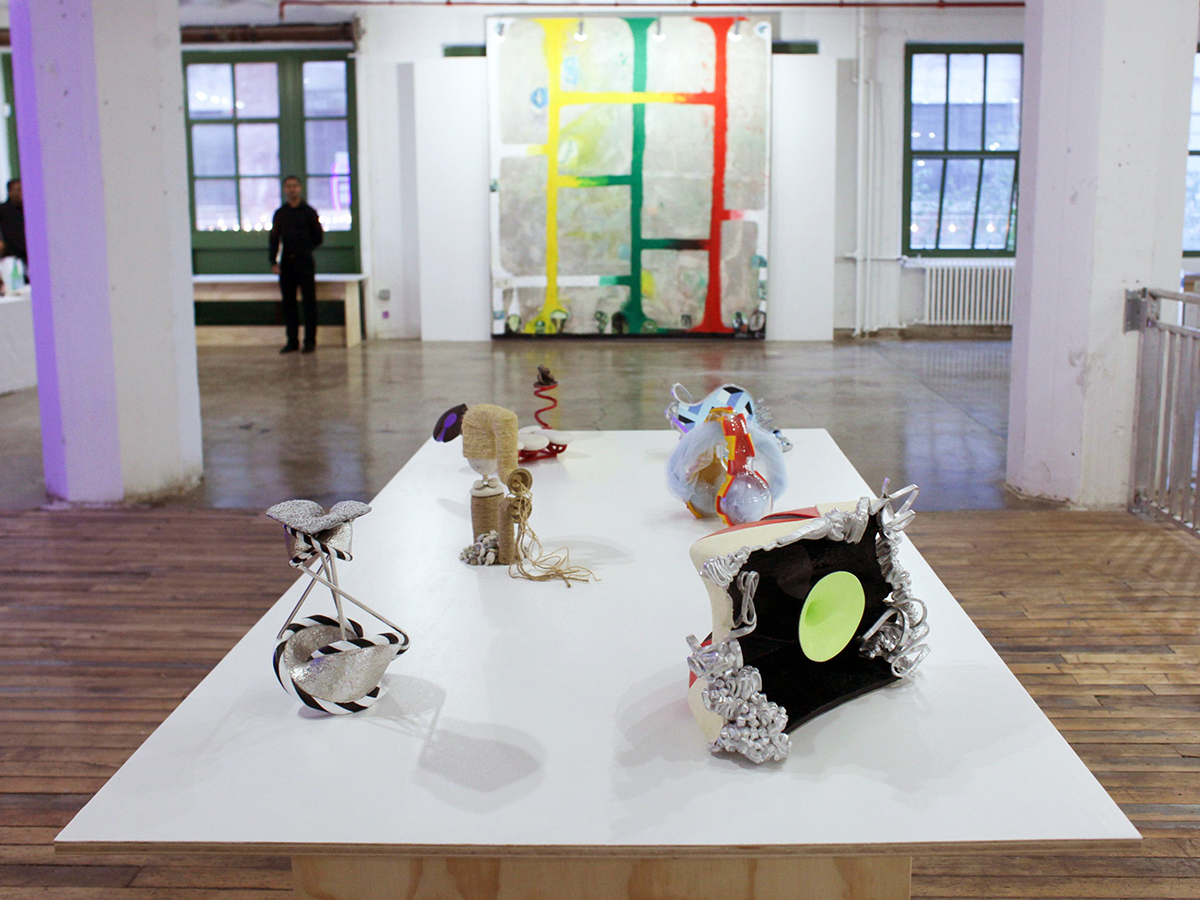 "Chris Martin, ""Red, Yellow, Green #1,"" and John Newman, clockwise from top: ""White stones and keyhole,"" ""Ask the fact for the form (after mask),"" ""Primaries retort,"" ""Danced mask small theatre,"" ""Black and white centerpiece,"" ""With a pile of stones."""
