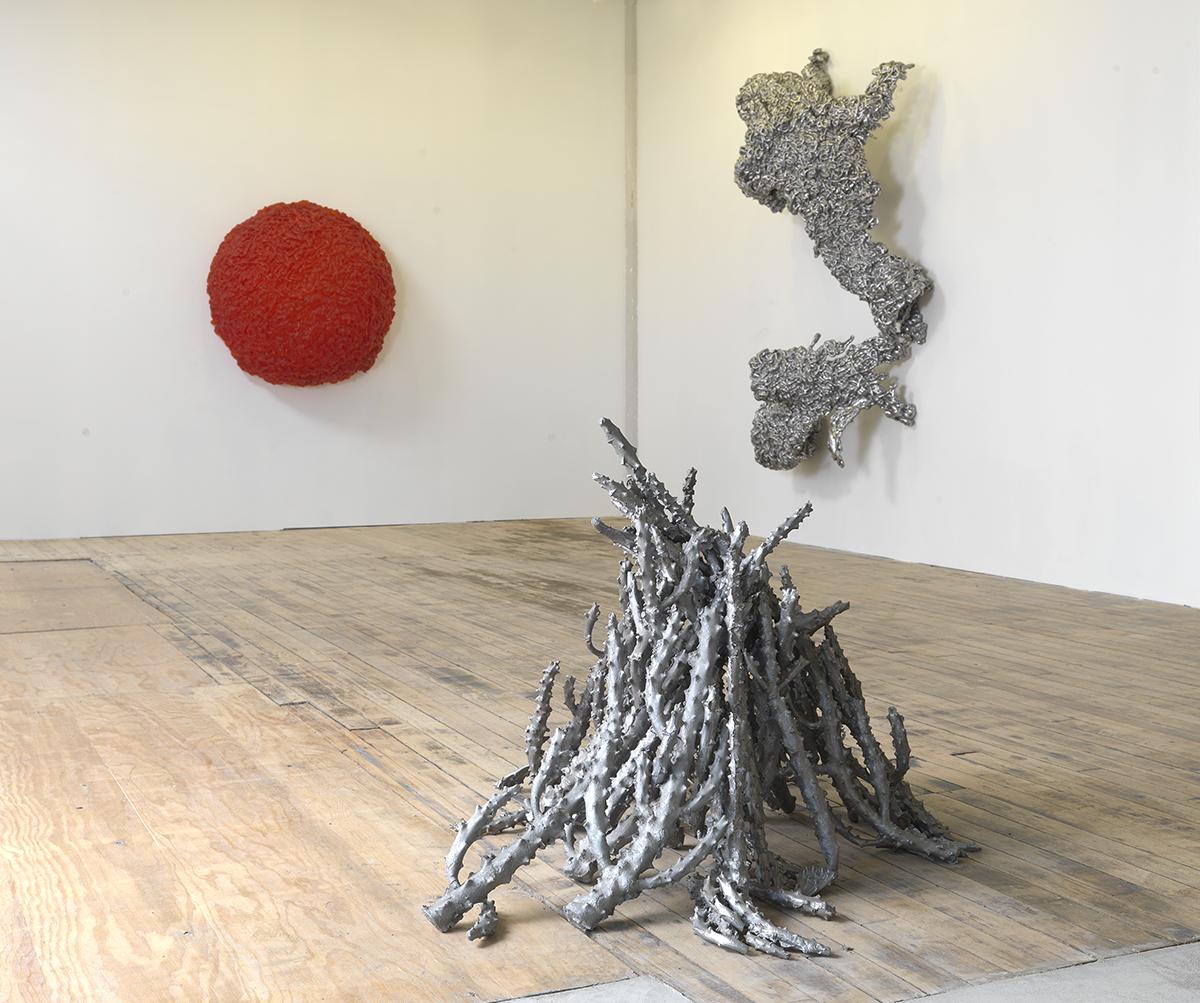 "Lynda Benglis, clockwise: ""Figure 5,"" 2009. Aluminum, 89 x 61 x 27"". ""Jacks #3,"" 1998-1999. Cast aluminum, 39 x 34 x 37"". ""D'Arrest,"" 2009."