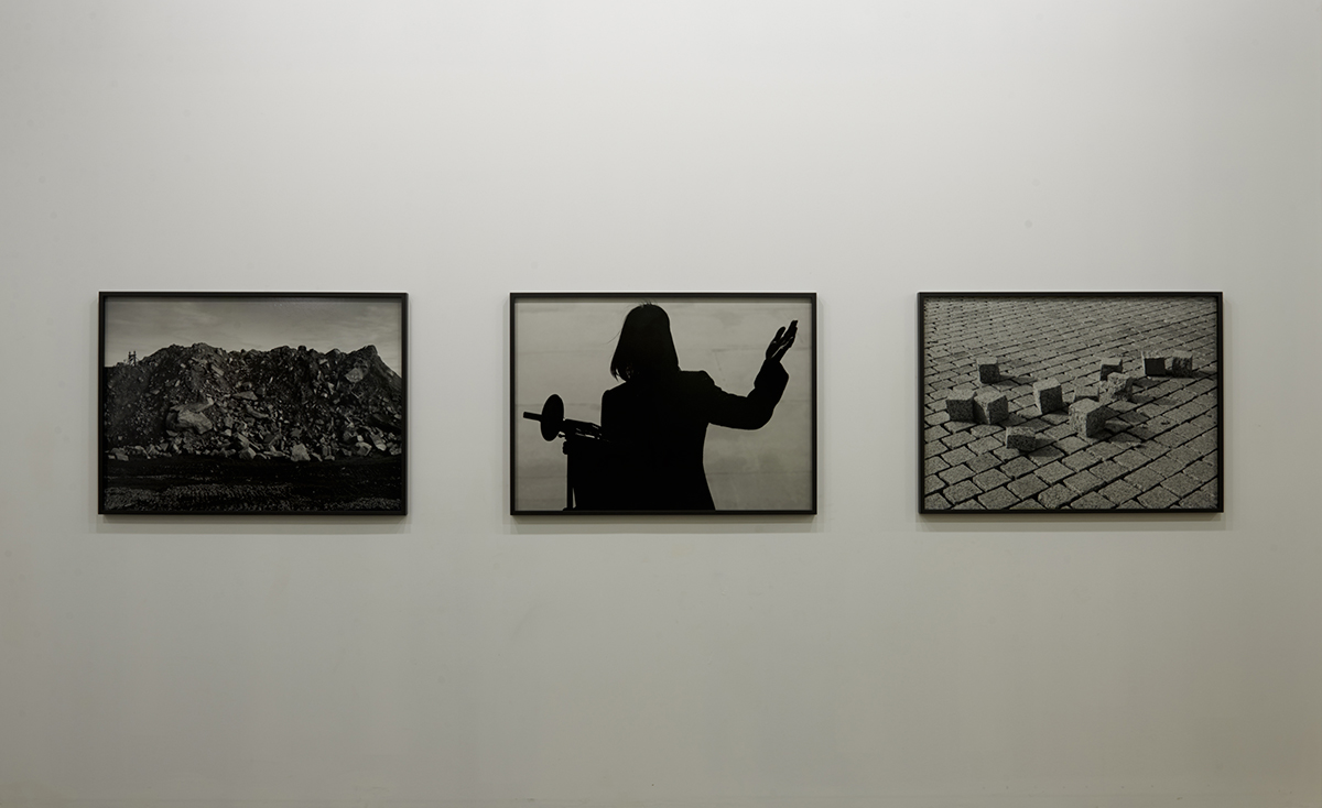 "Barney Kulok, L to R: ""Untitled (Cobble Constellation),"" 2011. Gelatin Silver Print, 29 x 40"". ""Council Woman,"" 2012. Gelatin Silver Print, 30 x 40"". ""59th St Bridge,"" 2012. Gelatin Silver Print, 30 x 40"". Courtesy of the artist. Photo by Zack Garlitos."